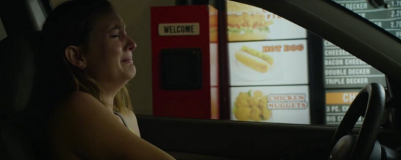 Sasha has a break down in a drive thru. (Photo Courtesy of Magnolia Pictures)